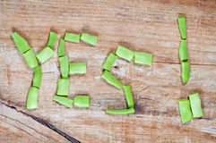 Yes word writen with green bean pieces Royalty Free Stock Image