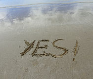 YES written on the beach sand Royalty Free Stock Images
