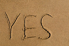 Yes written in sand Stock Photography