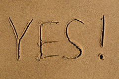 Yes written in sand Royalty Free Stock Photography