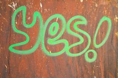 Yes wrote  on rusty brown background Royalty Free Stock Photography