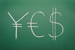 YES - Yen, Euro and Dollar signs written Stock Photos