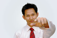 Yes.. you!. Executive male pointing finger stock photo