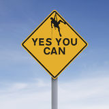Yes You Can. A conceptual road sign with a motivational message. (Terms of Use of silhouette allows for commercial application Stock Photo