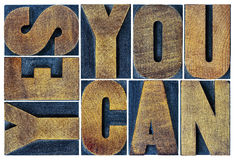 Yes you can motivation phrase in wood type Stock Photography