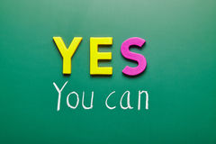 Yes you can, words on blackboard Stock Image