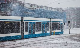 Blue tram in a snowy day. Stock Image