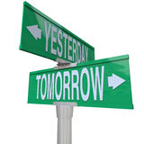 Yesterday and Tomorrow - Two-Way Street Sign. A green two-way street sign pointing to Right Way and Wrong Way Stock Photo