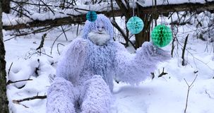Yeti fairy tale character in winter forest. Outdoor fantasy 4K footage. stock footage