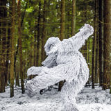 Yeti fairy tale character in winter forest. Outdoor fantasy photo. Yeti fairy tale character in winter forest. Outdoor fantasy photo Royalty Free Stock Image