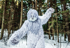 Yeti fairy tale character in winter forest. Outdoor fantasy photo. stock photos