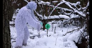 Yeti fairy tale character in winter forest. Outdoor fantasy slow motion footage. stock footage