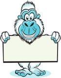 Yeti holding sign. Funny image of Yeti holding blank sign Royalty Free Stock Image