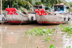 Yeux de bateaux dans le delta du Mékong Photos stock