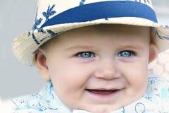 Yeux de bleu layette heureux Photos stock