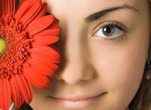 Yeux et fleur de femme Images stock