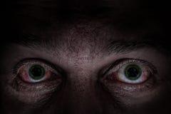 Yeux verts effrayants Photo libre de droits