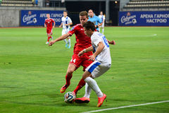 Yevgen Konoplyanka trying to pick up the ball from Dmitry Yusov Royalty Free Stock Images