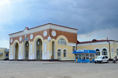Yevpatoria, Crimea, July, 04, 2016. Cars near train station in Yevpatoria in cloudy weather Royalty Free Stock Photos