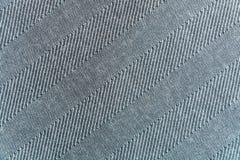 Yheachtergrond, textuur van grijze gestreepte wollen doek Stock Afbeelding