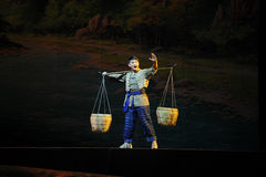 The Yi Nationality youth- Jiangxi opera a steelyard Stock Photo