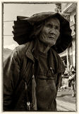 Yi old woman  in ethnic dress Stock Photos