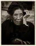 Yi old woman  in ethnic dress Royalty Free Stock Images