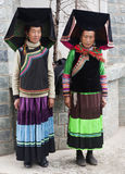 Yi People minority group in China. Two Yi woman dressed in their traditional clothing in the northern region of Yunnan province in China Royalty Free Stock Photo