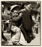 Yi woman carring a child Stock Image