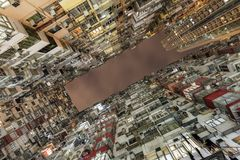 Yick Fat Building otherwise called Concrete jungle located in Hong Kong which is one of densely populated human settlement.  Stock Photo