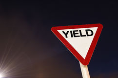 Yield. Road sign with rays of light stock images