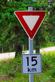A yield with a maximum 15 km sign below it Stock Images