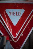 Yield road signs staked on top of each other. 