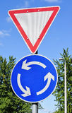 Yield and roundabout signs Royalty Free Stock Images