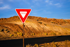 Yield Sign. At sunrise on a desert road stock images