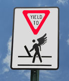 Yield Sign. A sign warning motorists to yield to pedestrians stock photos