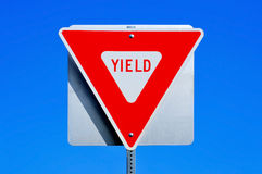 Yield sign. A yield traffic sign in a road royalty free stock images