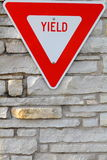 Yield sign. Red and white yield sign royalty free stock images