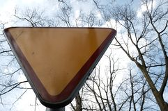 Yield sign against the sky Stock Photography