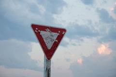Yield Sign with Bullet Holes. An old yield sign that has been shot multiple times stock photo