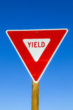 Yield Sign at the highway with blue. Sky royalty free stock image