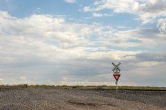 Yield Sign at Railroad Crossing. A Yield Sign at Railroad Crossing in western USA stock photography