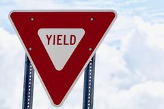 Yield sign. Red and White Yield Sign Horizontal royalty free stock image