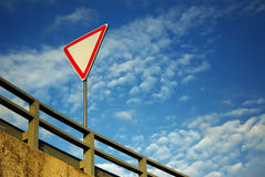 Yield sign. On the road royalty free stock photo