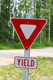 A yield sign with the written word below it.  stock photos