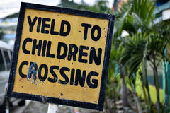 Yield to Children` sign. A hand made wonky `Yield to Children` sign in yellow and black stock images