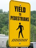 Yield to pedestrian sign. Near a road royalty free stock image
