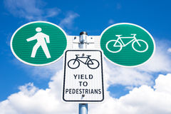 Yield to pedestrians road sign Stock Photo