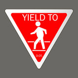 Yield to pedestrians traffic Stock Photography