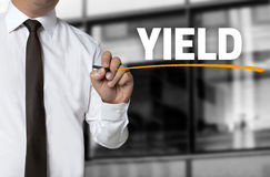 Yield written by businessman background concept.  royalty free stock photo